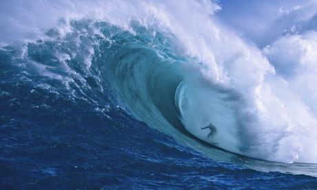 Surfer at Peahi Bay on Maui, Hawaii
