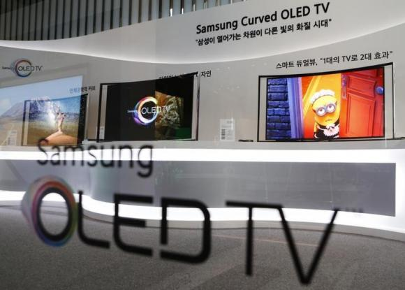 Samsung Electronics' first curved, super-thin OLED television sets are displayed at the main office of the company in Seoul