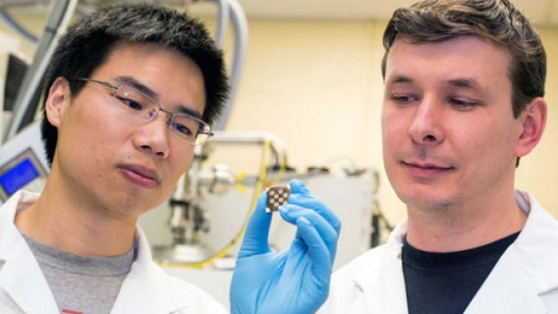U of Toronto professor-sargent-s-lab-members-zhijun-ning-and-oleksandr-vozny-examining-a-new-paint-on-solar-chi