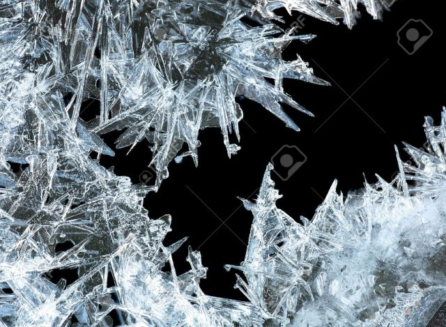 frost-903666-close-up-of-ice-crystals-forming-spiky-ornaments-stock-photo