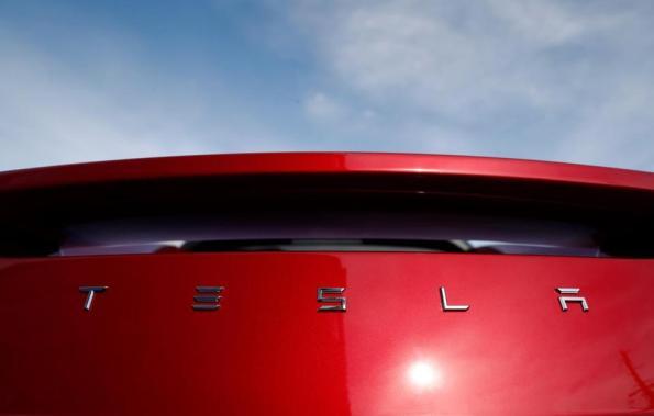 Tesla Red Car 0e0c44e592964b68aad7d2cefa03807b-0e0c44e592964b68aad7d2cefa03807b-0